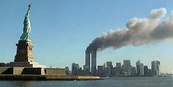 View of Statue of Liberty with Twin Towers Burning